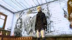 Das blonde Mädchen in schwarzer Kleidung